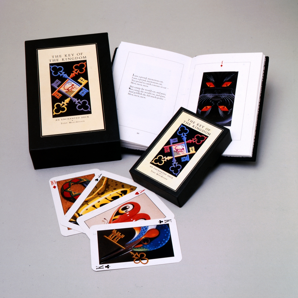 Photo of a book and a pack of cards